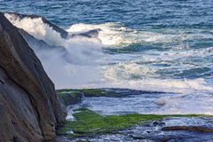 Sea water spray over the stones Stock Images