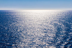 Sea water with sun reflections Stock Image