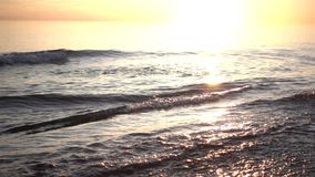 Sea water at sunset stock video footage