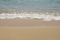 Sea water surf to beach in sunny day Royalty Free Stock Images