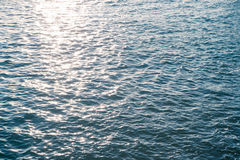 Sea water surface close up with sparkling sun light in evening Stock Photography