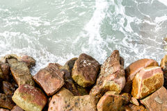 Sea water surface and stone/rock, background/texture Royalty Free Stock Images
