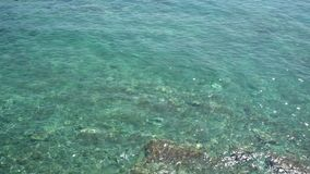 Sea water surface top view. Near coast stock video footage