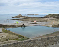 Sea Water Swimming Pool, St.Malo. ST.MALO, FRANCE, JULY 15 2015: View of the Outdoor seawater swimmingpool and the Grand Bé seen from the ramparts of St.Malo Royalty Free Stock Photos
