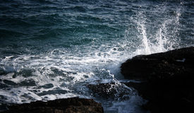 Sea wave. Is crushing on the shore rocks and making big white splash and foam Stock Photos