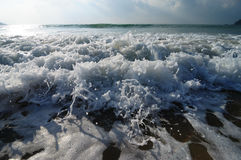 Sea wave. Coming turbulent on the beach Royalty Free Stock Photos