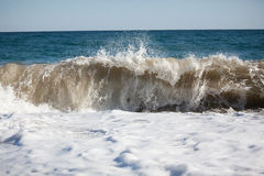 Sea wave. Rolls on beach on a summer day Royalty Free Stock Photo