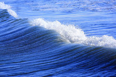 Sea wave. Little blue sea wave on a sand beach Stock Photos