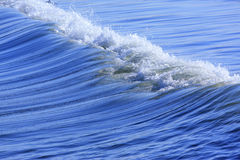 Sea wave. Little blue sea wave on a sand beach Royalty Free Stock Photography