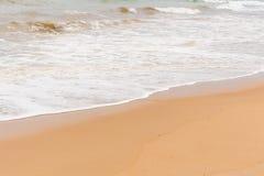 Sea wave and beach on evening Stock Photos