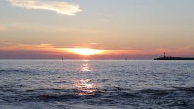 Sea wave on the beach at sunset time. stock footage