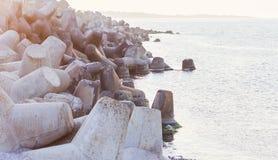 Sea and wave breaker. Stone concrete rocks wave and sea breaker Stock Photos