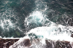 Sea wave breaking against coast cliff Stock Photography