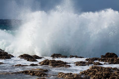 Sea wave breaking against coast  rock Royalty Free Stock Image