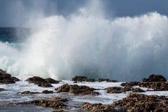 Sea wave breaking against coast rock. Storm. Sea wave breaking against coast rock. Mediterranean Royalty Free Stock Image