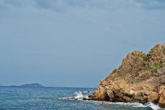 Sea wave breaks on beach rocks landscape. Sea waves crash and splash on rocks at Bodrum, Turkey.  stock photo