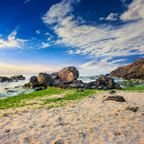 Sea wave breaks about boulders Royalty Free Stock Image