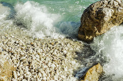 Sea wave is broken about stones. stock images