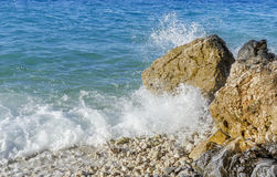 Sea wave is broken about stones. stock photo