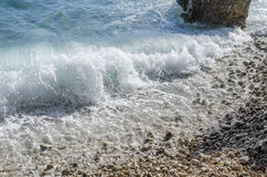 Sea wave is broken about stones. stock photos