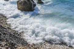 Sea wave is broken about stones. stock image