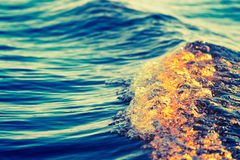 Sea wave. Close up, low angle view, cross processing effect Stock Photo