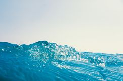 Sea wave close up, low angle view water background. Summer royalty free stock image