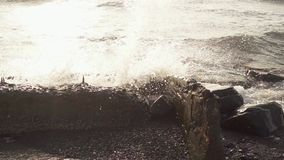 Sea wave crashes on concrete reinforcement slow mo. Slow motion sea wave crashes on concrete reinforcement stock video footage