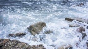 Sea wave crashing on rock royalty free stock photography