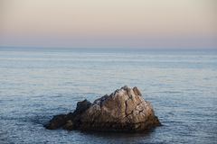 Sea wave foam and rocks on the beach in Estepona, Andalucia, Spain. Peaceful ocean waves at beach.  stock photography