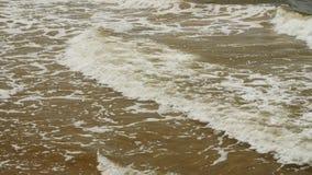 Sea wave foam washing beach on sunny summer day stock footage