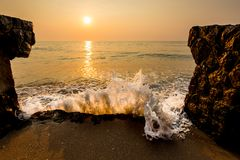 Sea wave hit the shore in the morning. royalty free stock photo