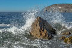Sea Wave Hiting Rock Stock Photo