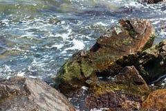 Sea wave hits rocks Stock Photos