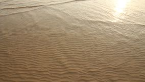 Sea wave over sand Royalty Free Stock Image