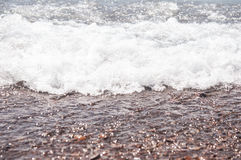 sea wave and pebble beach Stock Images