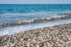 Sea wave on a pebbly beach. Black sea Royalty Free Stock Images