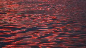 Sea wave reflection of sunset light stock video