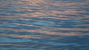 Sea wave reflection of sunset light stock footage