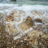 Sea wave and rock Royalty Free Stock Photography
