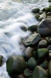 Sea wave through rocks Royalty Free Stock Photo