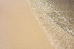 Sea wave and sand Stock Photo