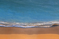 Sea wave and sand Stock Image