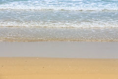 Sea wave on the sand beach. Abstract natural background stock photography