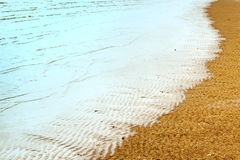 Sea wave and sand Stock Photography