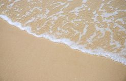 Sea wave and sand beach photo for background. Sunny beach sand with sea wave. Stock Images