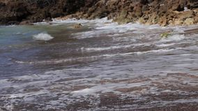 Sea wave on the sand of the tropical beach stock video footage