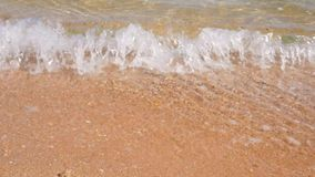 Sea wave on the sand of the tropical beach close-up. HD stock video footage