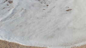 Sea wave on the sand of the tropical beach stock video