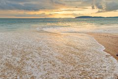 A sea wave on the sandy beach of Ao Nang in Thailand, a beautifu. L landscape at sunset Royalty Free Stock Photos
